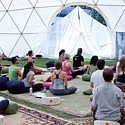 Savitri leading a meditation at Wanderlust
