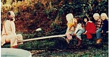 Swami on seesaw with children