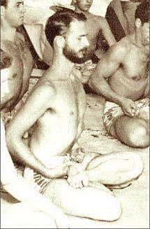 Swami Kriyananda meditating with a group of monks.